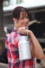 Farmer carrying milk