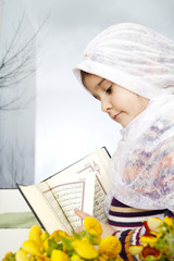 Little muslim girl with Koran