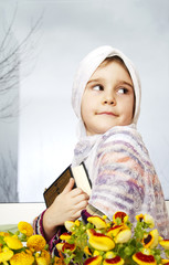 Little muslim girl with Koran