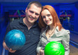 Happy couple in a bowling