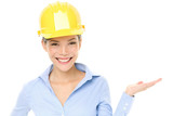Hard hat engineer or architect woman showing