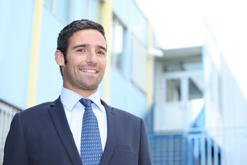 Smiling businessman outside a building