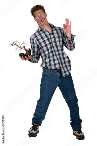 Strange man stood with burnt plant