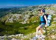 Female in mountains look in binocular