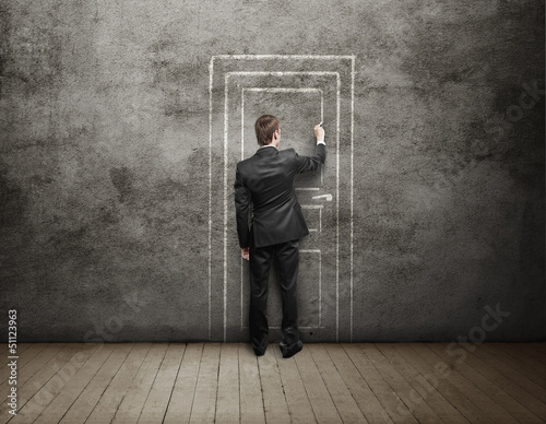 businessman drawing door