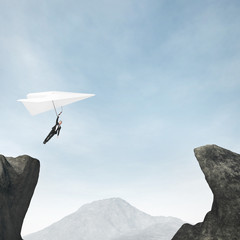 businessman flying on paper plane