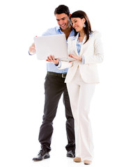 Business couple with a laptop