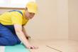 cork worker at flooring work