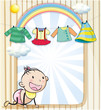 A baby girl with hanging clothes