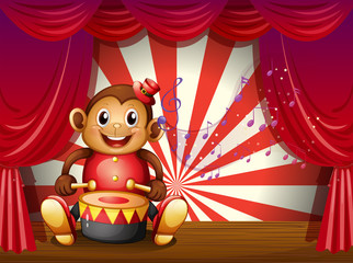 A monkey playing with a musical instrument at the stage