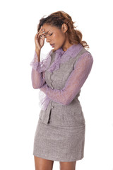 Woman in business attire is stressed out.