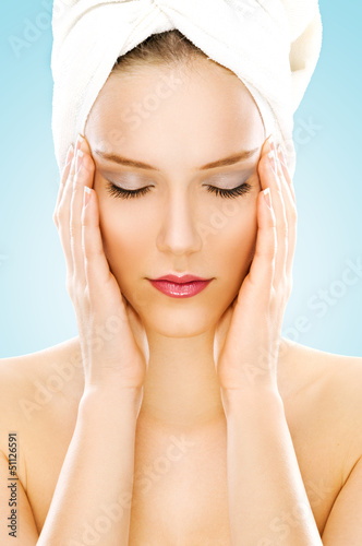 Beauty with towel isolated on blue