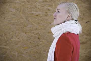 Woman face profile with white woven scarf