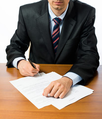 businessman writing on a form