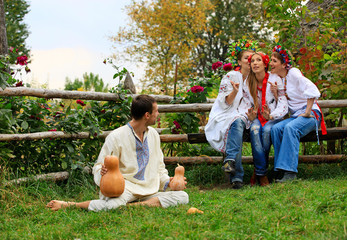 Young people dressed in Ukrainian style clothing shirts flirting