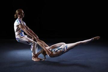Circus artists perform different tricks.