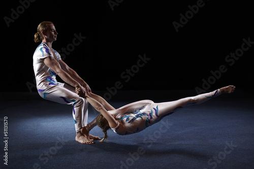 Fotobehang Fitness Circus artists perform different tricks.