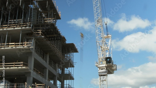 White tower crane at construction site. Timelapse.