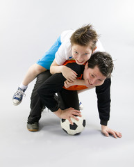 Father and son with football ball