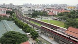 Singapore MRT Subway Trains Moving on Tracks in Eunos District