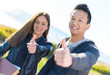 Young Couple Showing Thumb Up Sign