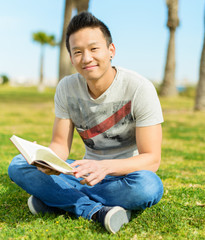 Man Holding Book In Park