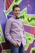 Style teen boy near graffiti background.