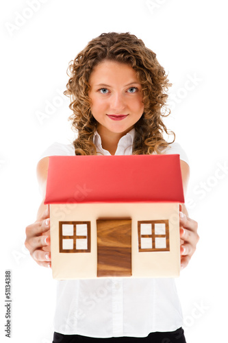 Woman holding model of house isolated on white