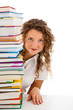 Young woman behind pile of books isolated on white background