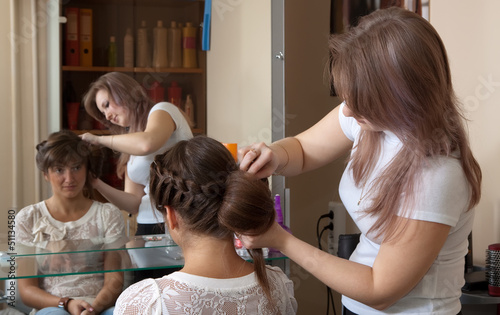 hair stylist work on woman hair