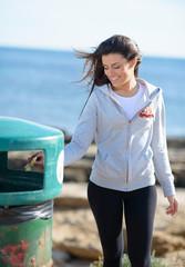 Woman Throwing Paper In Garbage Bin