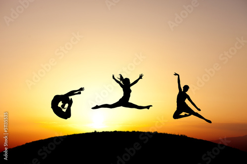 silhouette of dancer on hill
