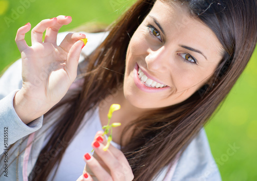 Young Woman Picking Leaf