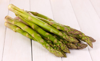Fresh asparagus on white wooden table background