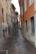 narrow street with houses and housing part for part in a Italian
