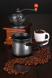 Coffee maker and coffee mill on brown table