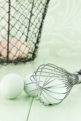 Fresh farm eggs and whisk