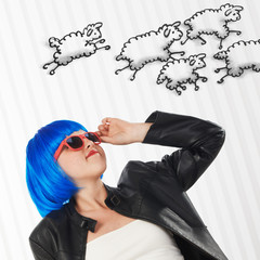 girl with blue wig counting sheep