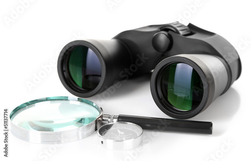 Black modern binoculars with magnifying glass and compass