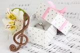Treble clef, flower and box holding wedding ring