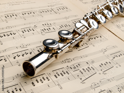 Silver flute on an ancient musical background - 51138547