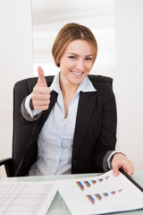 Businesswoman Showing Thumb-up