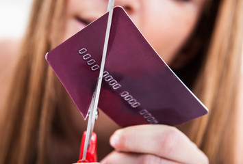 Close-up Of Hand Cutting Credit Card