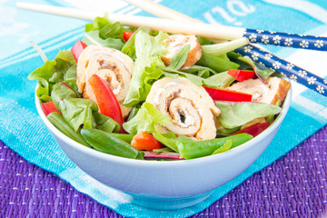 Snack with lettuce, rucola, vegetables and egg roll