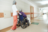 Nurse with elderly patient in wheelchair