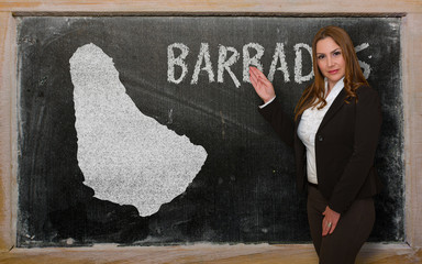 Teacher showing map of barbados on blackboard