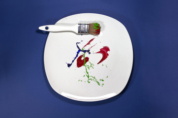 Paintbrush on the painted plate