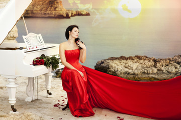 Beautiful bride in red wedding dress with piano outdoors