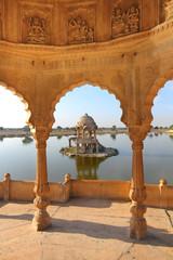 old jain cenotaphs on lake in jaisalmer india