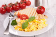 scrambled egg with bread and tomatoes